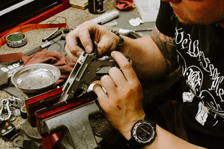 Student examining a handgun
