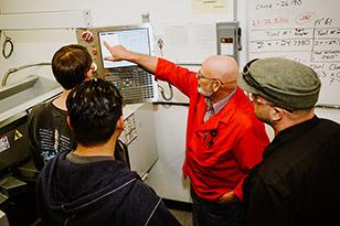 Students at CNC Machine