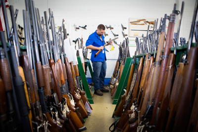 An employee in the large, fully operational gun shop that resides in Denver, Colorado.